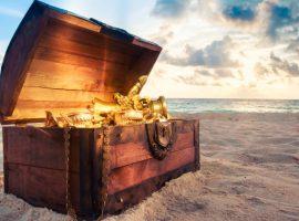 Open treasure chest on the beach