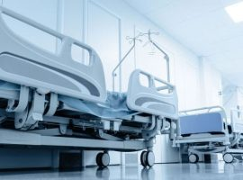 long corridor in hospital with surgical beds.