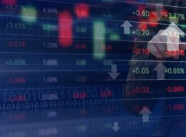 Double exposure of business woman and stock market graph