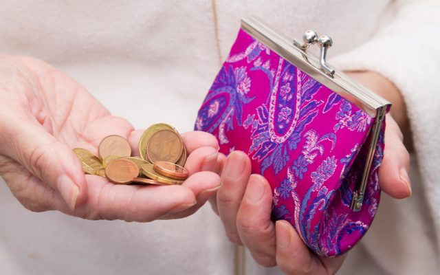 hand with coins saving on wallet